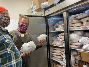 volunteers stock meat freezer