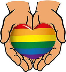 pride heart held in hands